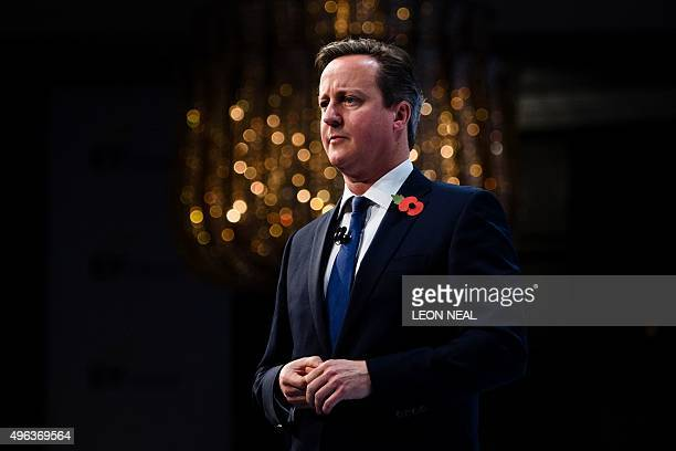British Prime Minister David Cameron addresses delegates at the annual Confederation of British Industry conference in central London on November 9...