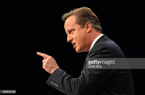 British Prime Minister David Cameron addresses delegates at the annual Conservative Party Conference in Manchester northwest England on October 2...