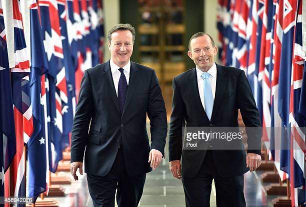 British Prime Minister David Cameron and Australian Prime Minister Tony Abbott leave the House of Representatives at Parliament House on November 14...