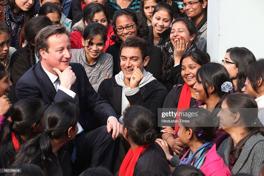 British Prime Minister <a gi-track='captionPersonalityLinkClicked' href=/galleries/search?phrase=David+Cameron+-+Politician&family=editorial&specificpeople=227076 ng-click='$event.stopPropagation()'>David Cameron</a> and Bollywood Actor and brand Ambassador of UNICEF Aamir Khan promote child nutrition in India during their interaction with students at Janki Devi Memorial College, on February 19, 2013 in New Delhi, India.