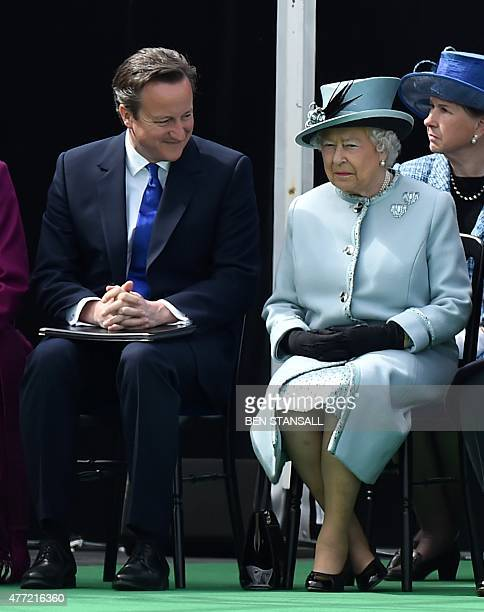 British Prime Minister David Cameron and Britain's Queen Elizabeth II talk as they attend a service to mark the 800th anniversary of Magna Carta at...