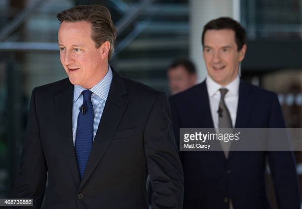 British Prime Minister David Cameron and British Chancellor George Osborne arrive to speak to party supporters gathered at the Bristol and Bath...