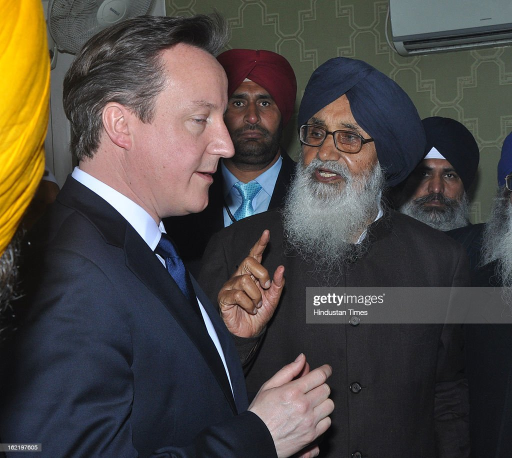 British Prime Minister <a gi-track='captionPersonalityLinkClicked' href=/galleries/search?phrase=David+Cameron+-+Politician&family=editorial&specificpeople=227076 ng-click='$event.stopPropagation()'>David Cameron</a> and Chief Minister Punjab Parkash Singh Badal sharing a point during his visit of Golden Temple, on February 20, 2013 in Amritsar, India.