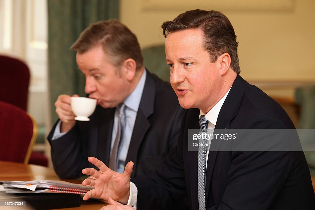 British Prime Minister <a gi-track='captionPersonalityLinkClicked' href=/galleries/search?phrase=David+Cameron+-+Politician&family=editorial&specificpeople=227076 ng-click='$event.stopPropagation()'>David Cameron</a> (R) and Education Secretary <a gi-track='captionPersonalityLinkClicked' href=/galleries/search?phrase=Michael+Gove&family=editorial&specificpeople=2223709 ng-click='$event.stopPropagation()'>Michael Gove</a> (L) attend a meeting on education in Number 10 Downing Street on January 17, 2012 in London, England. The meeting brought together educational professionals with experience of improving pupil underperformance and included Ofsted's Chief Inspector, Sir Michael Wilshaw.