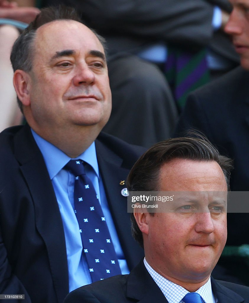 British Prime Minister <a gi-track='captionPersonalityLinkClicked' href=/galleries/search?phrase=David+Cameron+-+Politician&family=editorial&specificpeople=227076 ng-click='$event.stopPropagation()'>David Cameron</a> and First Minister of Scotland <a gi-track='captionPersonalityLinkClicked' href=/galleries/search?phrase=Alex+Salmond&family=editorial&specificpeople=857688 ng-click='$event.stopPropagation()'>Alex Salmond</a> attend the Gentlemen's Singles Final match between Andy Murray of Great Britain and Novak Djokovic of Serbia on day thirteen of the Wimbledon Lawn Tennis Championships at the All England Lawn Tennis and Croquet Club on July 7, 2013 in London, England.
