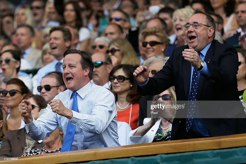 British Prime Minister David Cameron and First Minister of Scotland Alex Salmond celebrate during the Gentlemen's Singles Final match between Andy Murray of Great Britain and Novak Djokovic of Serbia on day thirteen of the Wimbledon Lawn Tennis Championships at the All England Lawn Tennis and Croquet Club on July 7, 2013 in London, England.