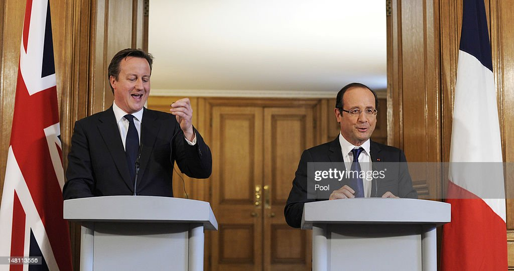 British Prime Minister <a gi-track='captionPersonalityLinkClicked' href=/galleries/search?phrase=David+Cameron+-+Politician&family=editorial&specificpeople=227076 ng-click='$event.stopPropagation()'>David Cameron</a> (L) and French President Francois Hollande speak in Number 10 Downing Street on July 10, 2012 in London, England. This is the French President's first official visit to the United Kingdom since taking office, during which he will attend meetings with British Prime Minister <a gi-track='captionPersonalityLinkClicked' href=/galleries/search?phrase=David+Cameron+-+Politician&family=editorial&specificpeople=227076 ng-click='$event.stopPropagation()'>David Cameron</a> and Queen Elizabeth II.
