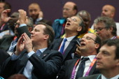 British Prime Minister David Cameron and French President Francois Hollande watch the Women's Handball Preliminaries Group B Match 10 between France...