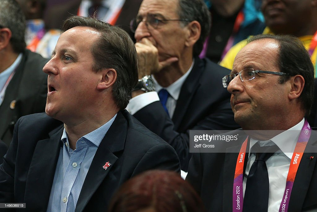 British Prime Minister <a gi-track='captionPersonalityLinkClicked' href=/galleries/search?phrase=David+Cameron+-+Politician&family=editorial&specificpeople=227076 ng-click='$event.stopPropagation()'>David Cameron</a> and French President Francois Hollande watch the Women's Handball Preliminaries Group B - Match 10 between France and Spain on Day 3 of the London 2012 Olympic Games at the Copper Box on July 30, 2012 in London, England.