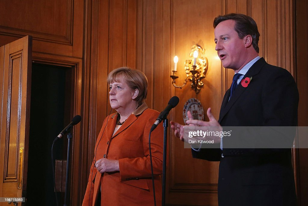 British Prime Minister <a gi-track='captionPersonalityLinkClicked' href=/galleries/search?phrase=David+Cameron+-+Politician&family=editorial&specificpeople=227076 ng-click='$event.stopPropagation()'>David Cameron</a> and German Chancellor <a gi-track='captionPersonalityLinkClicked' href=/galleries/search?phrase=Angela+Merkel&family=editorial&specificpeople=202161 ng-click='$event.stopPropagation()'>Angela Merkel</a> speak to the press ahead of a bilateral meeting at 10 Downing Street on November 7, 2012 in London, England. Prime Minister Cameron and Chancellor Merkel are holding talks over increasing the EU's seven year budget, with the Prime Minister urging the Chancellor to stick to an agreement made in 2010 to freeze or cut it.