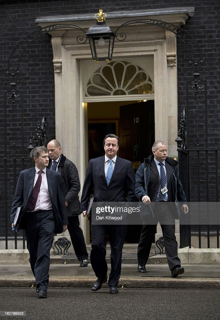 British Prime Minister <a gi-track='captionPersonalityLinkClicked' href=/galleries/search?phrase=David+Cameron+-+Politician&family=editorial&specificpeople=227076 ng-click='$event.stopPropagation()'>David Cameron</a> (C) and his aides leave 10 Downing Street on February 27, 2013 in London, England. Mr Cameron will deliver his weekly Prime Minister Questions at the Houses of Parliament later today.