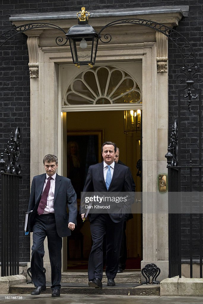 British Prime Minister <a gi-track='captionPersonalityLinkClicked' href=/galleries/search?phrase=David+Cameron+-+Politician&family=editorial&specificpeople=227076 ng-click='$event.stopPropagation()'>David Cameron</a> (R) and his aides leave 10 Downing Street on February 27, 2013 in London, England. Mr Cameron will deliver his weekly Prime Minister Questions at the Houses of Parliament later today.