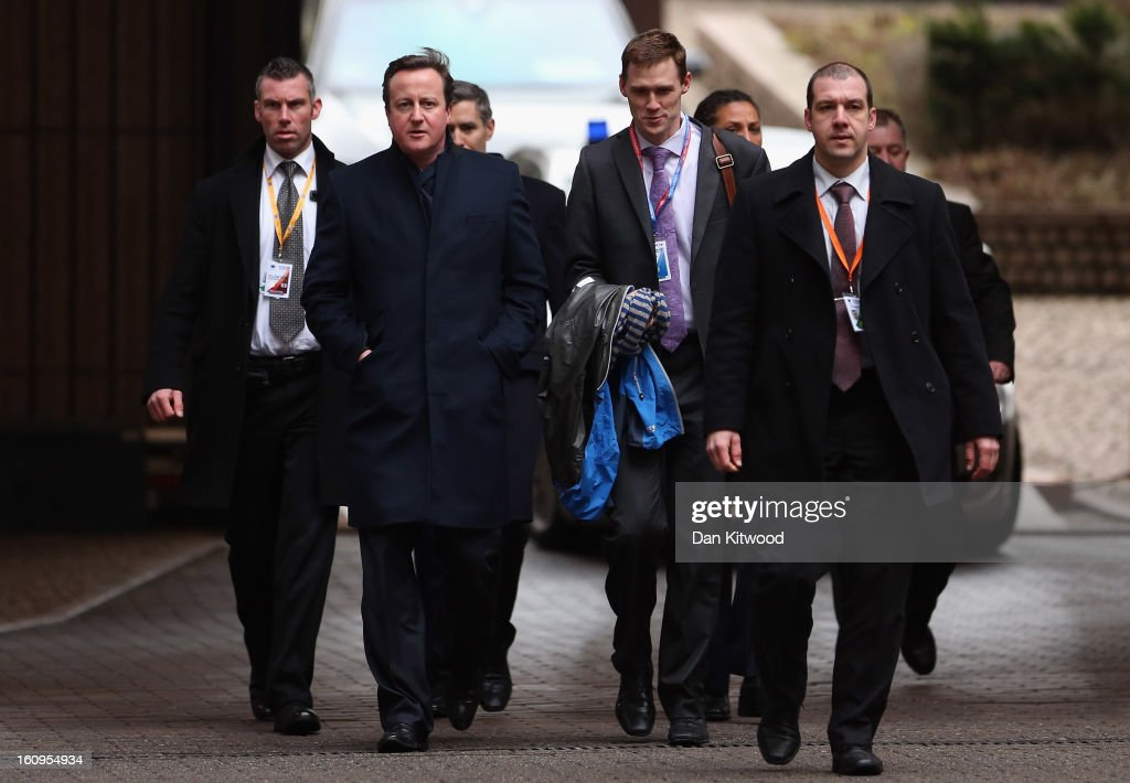 British Prime Minister <a gi-track='captionPersonalityLinkClicked' href=/galleries/search?phrase=David+Cameron+-+Politician&family=editorial&specificpeople=227076 ng-click='$event.stopPropagation()'>David Cameron</a> and his entourage arrive back at the headquarters of the Council of the European Union on February 8, 2013 in Brussels, Belgium. EU leaders have set out the framework for agreeing on a 2014-2020 EU budget during talks that continued through the night at the European Council Meetings in Brussels. The historic deal would see 34.4 billion Euros of EU spending cuts over the next 7 year period.