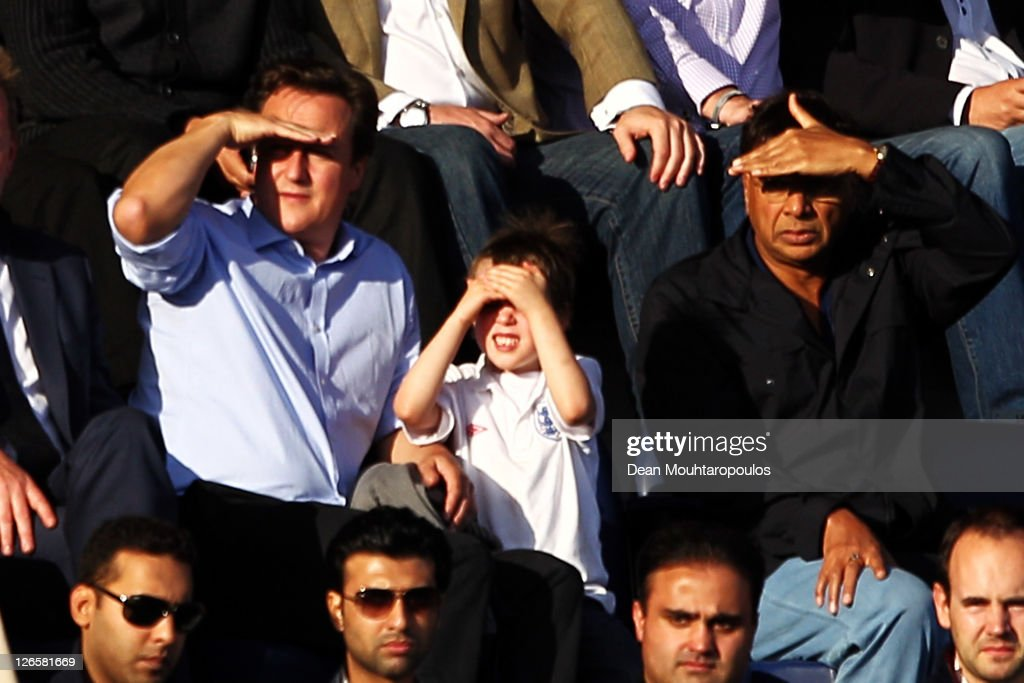 British Prime Minister David Cameron and his son Arthur sit with Indian Steel Magnate Lakshmi Mittal during the Barclays Premier League match between...