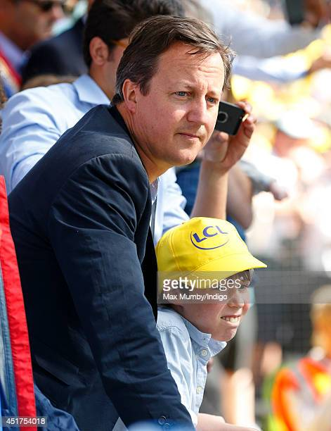British Prime Minister David Cameron and his son watch the finish of stage one of the Tour de France on July 5 2014 in Harrogate England