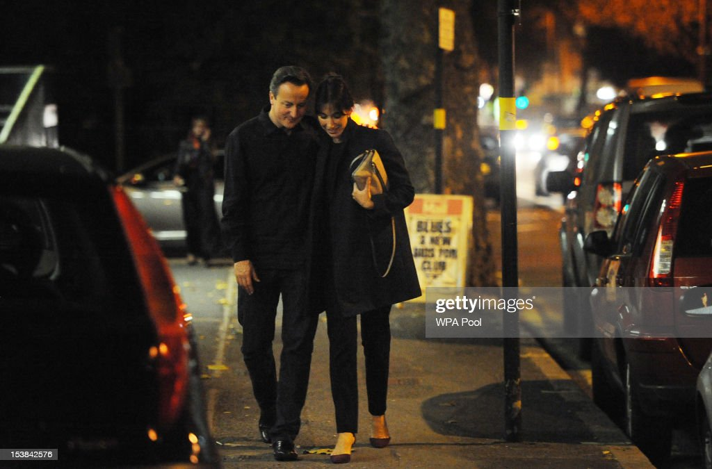 British Prime Minister <a gi-track='captionPersonalityLinkClicked' href=/galleries/search?phrase=David+Cameron+-+Politician&family=editorial&specificpeople=227076 ng-click='$event.stopPropagation()'>David Cameron</a> and his wife Samantha arrive at the Diwan Balti restaurant in Birmingham to celebrate his 46th birthday, whilst in the city for the Conservative Party conference on October 9, 2012 in Birmingham, England.