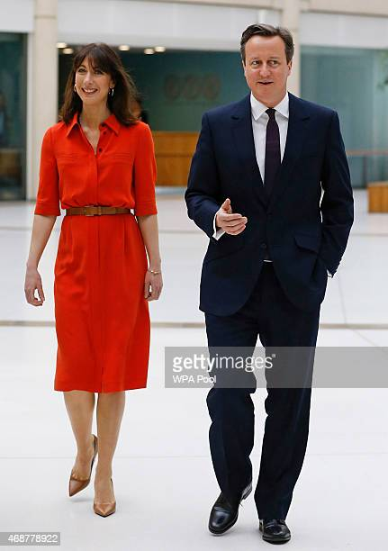 British Prime Minister David Cameron and his wife Samantha arrive for a visit to financial firm Scottish Widows on April 7 2015 in Edinburgh United...