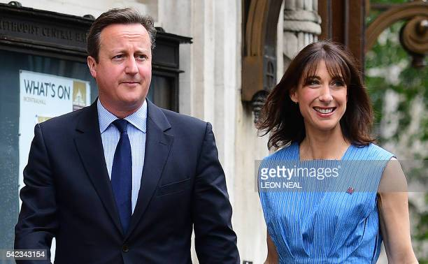 British Prime Minister David Cameron and his wife Samantha arrive to cast thier votes in the EU referendum at a polling station in London on June 23...