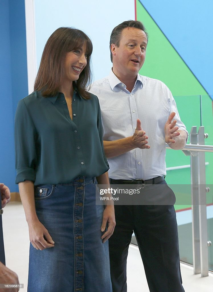 British Prime Minister <a gi-track='captionPersonalityLinkClicked' href=/galleries/search?phrase=David+Cameron+-+Politician&family=editorial&specificpeople=227076 ng-click='$event.stopPropagation()'>David Cameron</a> (L) and his wife <a gi-track='captionPersonalityLinkClicked' href=/galleries/search?phrase=Samantha+Cameron&family=editorial&specificpeople=624344 ng-click='$event.stopPropagation()'>Samantha Cameron</a> during a visit to the children's cancer ward at the John Radcliffe Hospital on September 28, 2013 in Oxford, United Kingdom. The Prime Minister has pledged £400m to the Cancer Drugs Fund, enabling cancer patients to access life-enhancing drugs before the NHS approves them for wide-spread use until 2016.
