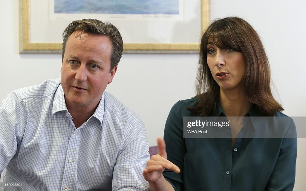 British Prime Minister <a gi-track='captionPersonalityLinkClicked' href=/galleries/search?phrase=David+Cameron+-+Politician&family=editorial&specificpeople=227076 ng-click='$event.stopPropagation()'>David Cameron</a> (L) and his wife <a gi-track='captionPersonalityLinkClicked' href=/galleries/search?phrase=Samantha+Cameron&family=editorial&specificpeople=624344 ng-click='$event.stopPropagation()'>Samantha Cameron</a> speak to cancer patients during a visit to the children's cancer ward at the John Radcliffe Hospital on September 28, 2013 in Oxford, United Kingdom. The Prime Minister has pledged £400m to the Cancer Drugs Fund, enabling cancer patients to access life-enhancing drugs before the NHS approves them for wide-spread use until 2016.