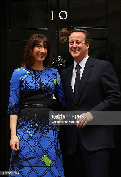 British Prime Minister David Cameron and his wife Samantha Cameron arrive at Downing Street on May 8 2015 in London England After the United Kingdom...