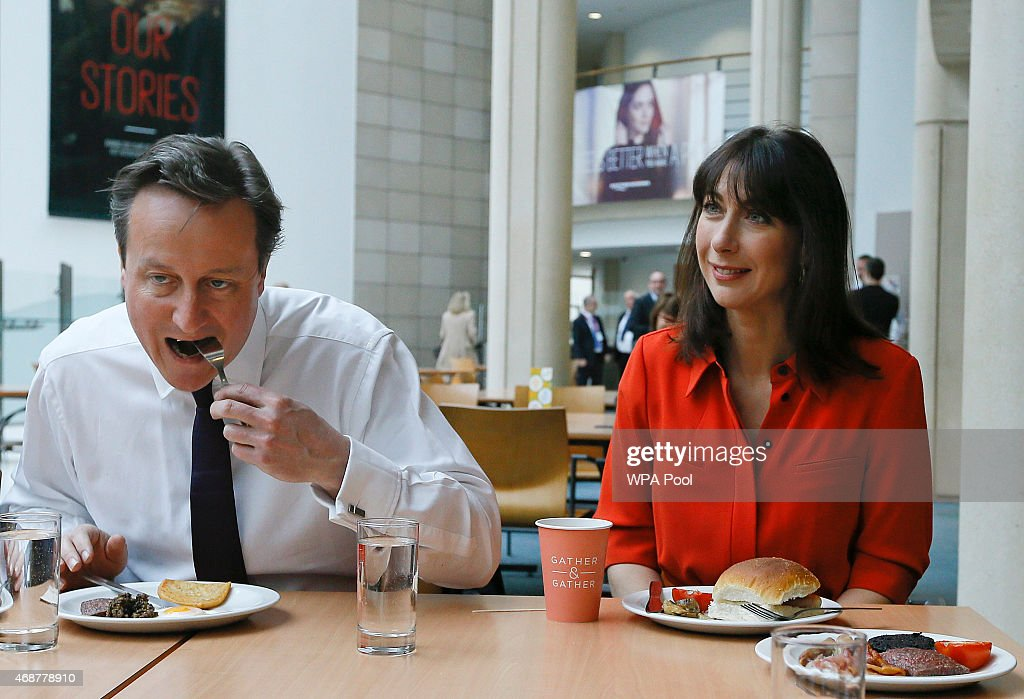 British Prime Minister <a gi-track='captionPersonalityLinkClicked' href=/galleries/search?phrase=David+Cameron+-+Politician&family=editorial&specificpeople=227076 ng-click='$event.stopPropagation()'>David Cameron</a> and his wife Samantha eat breakfast during a visit to financial firm Scottish Widows on April 7, 2015 in Edinburgh, United Kingdom. Britain goes to the polls in a General Election on May 7.