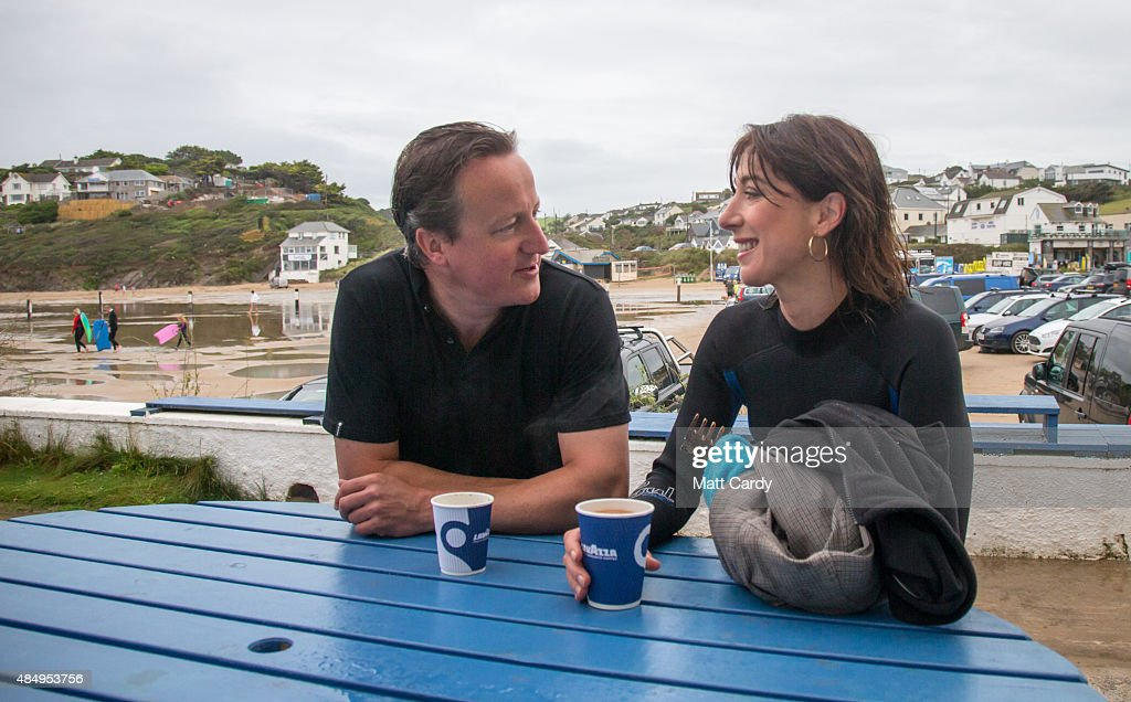 British Prime Minister David Cameron and his wife Samantha have a coffee outside the Galleon Beach Cafe following an early morning swim in the sea...