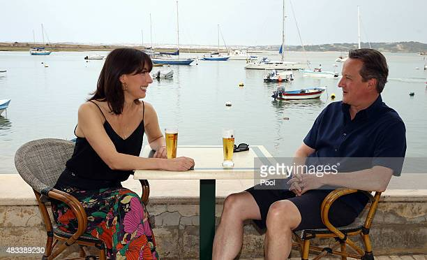 British Prime Minister David Cameron and his wife Samantha relax on holiday on August 8 2015 in Alvor Portugal