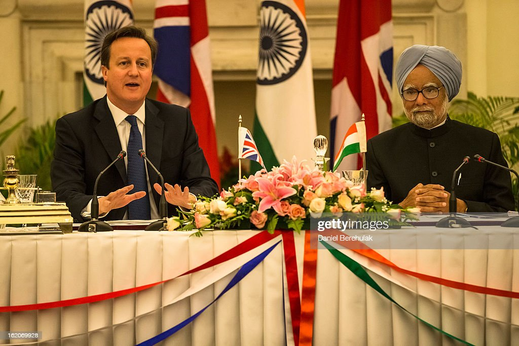 British Prime Minister <a gi-track='captionPersonalityLinkClicked' href=/galleries/search?phrase=David+Cameron+-+Politiker&family=editorial&specificpeople=227076 ng-click='$event.stopPropagation()'>David Cameron</a> and Indian Prime Minister <a gi-track='captionPersonalityLinkClicked' href=/galleries/search?phrase=Manmohan+Singh&family=editorial&specificpeople=227120 ng-click='$event.stopPropagation()'>Manmohan Singh</a> hold a press conference at Hyderabad House on February 19, 2013 in New Delhi, India. British Prime Minister <a gi-track='captionPersonalityLinkClicked' href=/galleries/search?phrase=David+Cameron+-+Politiker&family=editorial&specificpeople=227076 ng-click='$event.stopPropagation()'>David Cameron</a> arrived in India on Monday for an official three-day trip accompanied by a large business delegation from the UK.