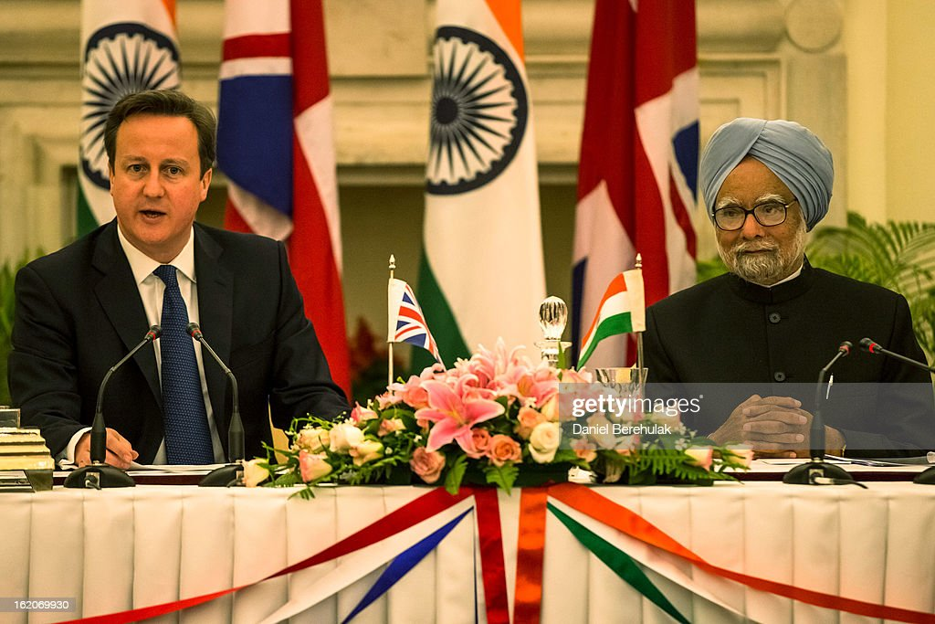British Prime Minister <a gi-track='captionPersonalityLinkClicked' href=/galleries/search?phrase=David+Cameron+-+Politician&family=editorial&specificpeople=227076 ng-click='$event.stopPropagation()'>David Cameron</a> and Indian Prime Minister <a gi-track='captionPersonalityLinkClicked' href=/galleries/search?phrase=Manmohan+Singh&family=editorial&specificpeople=227120 ng-click='$event.stopPropagation()'>Manmohan Singh</a> hold a press conference at Hyderabad House on February 19, 2013 in New Delhi, India. British Prime Minister <a gi-track='captionPersonalityLinkClicked' href=/galleries/search?phrase=David+Cameron+-+Politician&family=editorial&specificpeople=227076 ng-click='$event.stopPropagation()'>David Cameron</a> arrived in India on Monday for an official three-day trip accompanied by a large business delegation from the UK.