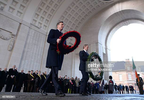 British Prime Minister David Cameron and Irish Prime Minister Enda Kenny lay wreathes at the Menin Gate in Ypres West Flanders Belgium on December 19...