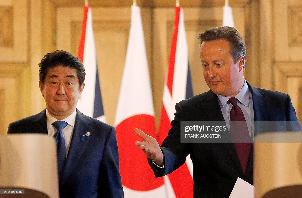 British Prime Minister David Cameron (R) and Japanese Prime Minister Shinzo Abe attend a joint press conference following their meeting inside 10 Downing Street in central London on May 5, 2016. Prime Minister Shinzo Abe warned that Britain would become 'less attractive' for Japanese investment if it votes to leave the European Union in a membership referendum in June. 'A vote to leave would make the UK less attractive as a destination for Japanese investment,' Abe said. / AFP / POOL / Frank Augstein