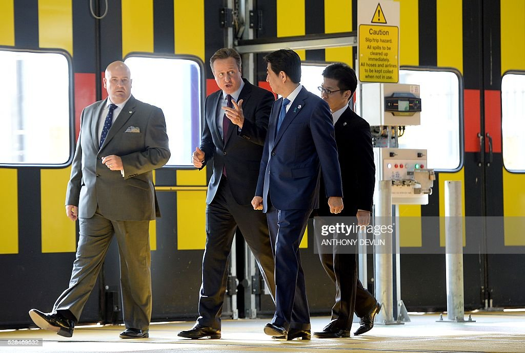 British Prime Minister David Cameron (2nd L) and Japanese Prime Minister Shinzo Abe (2nd R) are pictured as they tour the Hitachi North Pole train maintenance depot in west London, on May 5, 2016. Prime Minister Shinzo Abe on Thursday warned that Britain would become 'less attractive' for Japanese investment if it votes to leave the European Union in a membership referendum in June. / AFP / pool / Anthony Devlin