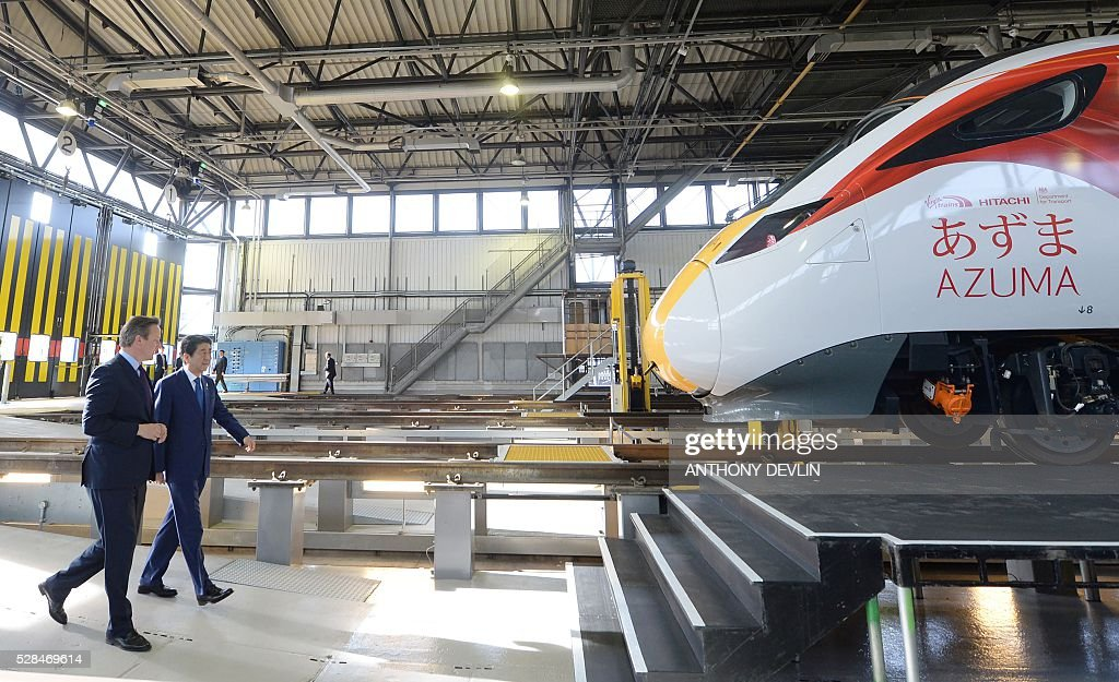British Prime Minister David Cameron (L) and Japanese Prime Minister Shinzo Abe are pictured as they tour the Hitachi North Pole train maintenance depot in west London, on May 5, 2016. Prime Minister Shinzo Abe on Thursday warned that Britain would become 'less attractive' for Japanese investment if it votes to leave the European Union in a membership referendum in June. / AFP / pool / Anthony Devlin