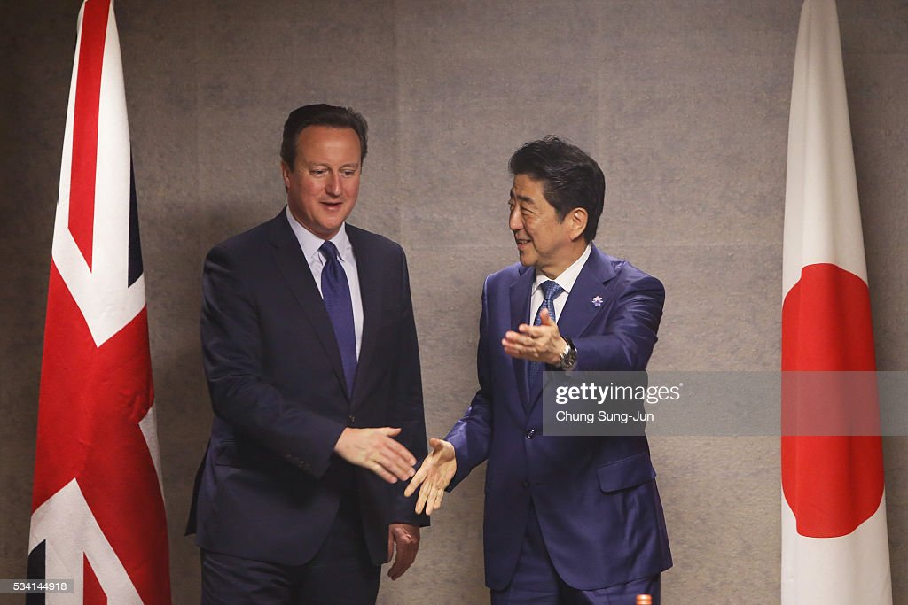 British Prime Minister <a gi-track='captionPersonalityLinkClicked' href=/galleries/search?phrase=David+Cameron+-+Politician&family=editorial&specificpeople=227076 ng-click='$event.stopPropagation()'>David Cameron</a> (L) and Japanese Prime Minister <a gi-track='captionPersonalityLinkClicked' href=/galleries/search?phrase=Shinzo+Abe&family=editorial&specificpeople=559017 ng-click='$event.stopPropagation()'>Shinzo Abe</a> (R) are seen during a bilateral meeting on May 24, 2016 in Shima, Japan. The G7 summit will be held on Japan's Kashikojima Island on May 26 and 27, 2016.