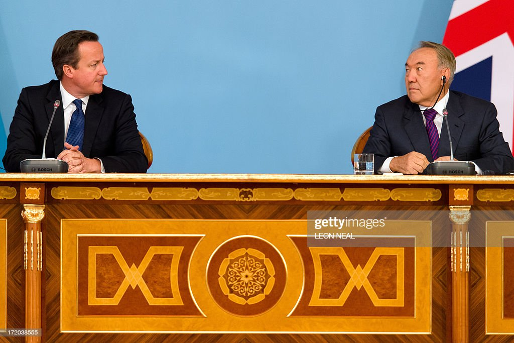 British Prime Minister David Cameron (L) and Kazakhstan President Nursultan Nazarbayev (R) hold a press conference after signing a strategic partnership agreement at the Presidential Palace in Astana, Kazakhstan on July 1, 2013. David Cameron arrived in Kazakhstan on June 30, 2013 on the first ever trip by a serving British prime minister, hoping to boost trade ties but also promising to raise human rights concerns.
