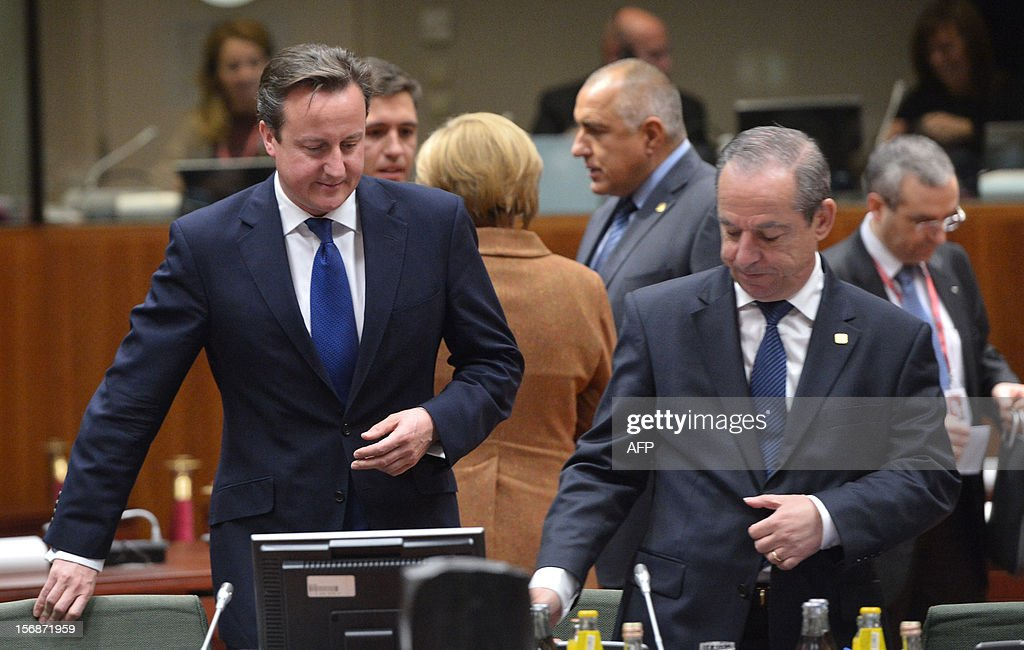 British Prime Minister David Cameron (L) and Maltese Prime Minister Lawrence Gonzi take a sit at the EU Headquarters on November 22, 2012 in Brussels, during a two-day European Union leaders summit called to agree a hotly-contested trillion-euro budget through 2020. European Union officials were scrambling to find an all but impossible compromise on the 2014-2020 budget that could successfully move richer nations looking for cutbacks closer to poorer ones who look to Brussels to prop up hard-hit industries and regions.