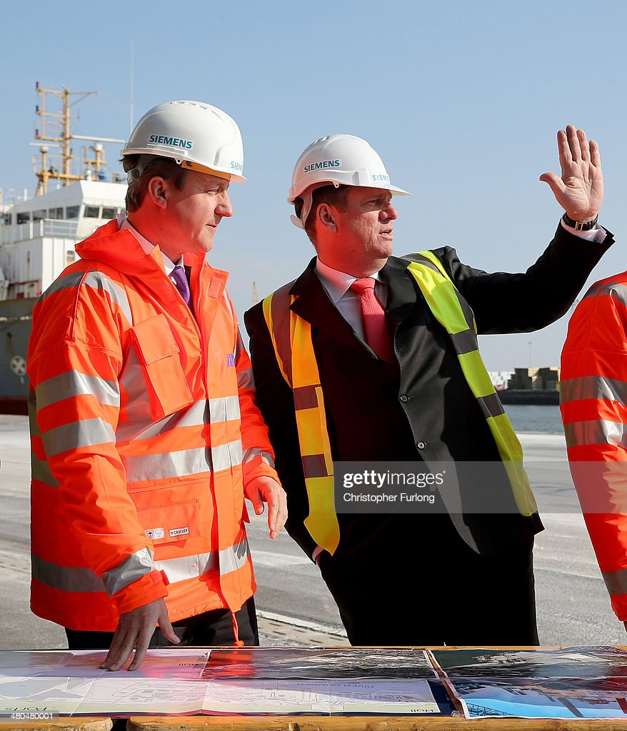 British Prime Minister David Cameron and Michael Suess (R) Chief Executive Officer of Siemens Energy, tour Alexandra Dock on March 25, 2014 in Hull, England. The Prime Minister visited the dock as it was announced that global engineering giant Siemens and Associated British Ports are to build a new wind turbine factory at Alexandra Dock in the City of Hull. Siemens are investing GBP 160m and creating 1000 jobs. Associated British Ports are also spending a further GBP 150m in the Green Port Hull development.