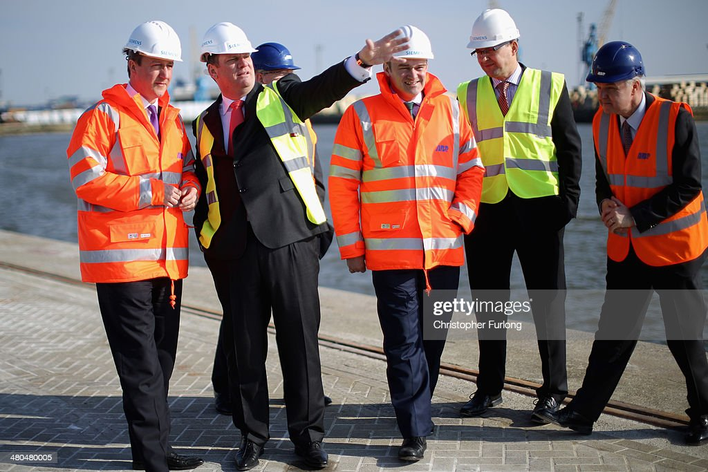 British Prime Minister David Cameron (L) and Michael Suess (2L) Chief Executive Officer of Siemens Energy, tour Alexandra Dock on March 25, 2014 in Hull, England. The Prime Minister visited the dock as it was announced that global engineering giant Siemens and Associated British Ports are to build a new wind turbine factory at Alexandra Dock in the City of Hull. Siemens are investing GBP 160m and creating 1000 jobs. Associated British Ports are also spending a further GBP 150m in the Green Port Hull development.
