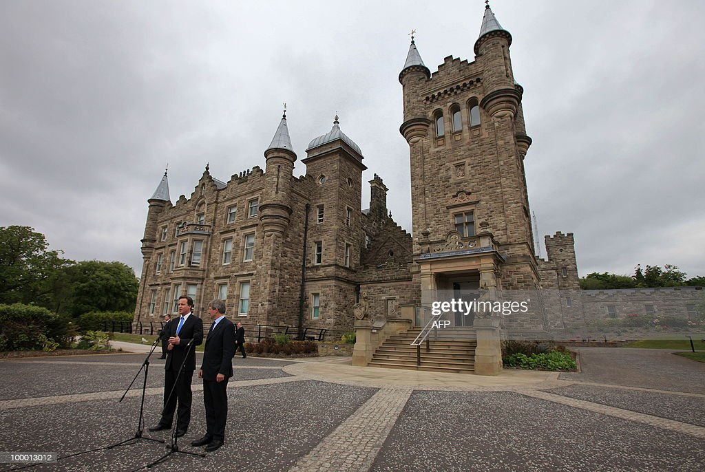 British Prime Minister David Cameron and Northern Ireland Secretary, Owen Paterson, address the media after meeting with Northern Ireland's First and Deputy First Ministers at Stormont Castle in Belfast, Northern Ireland May 20, 2010 . Cameron and his coalition deputy unveiled full details Thursday of their 'historic' power-sharing deal, under growing scrutiny for signs of strain. AFP PHOTO/Peter Muhly