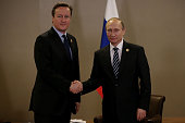 British Prime Minister David Cameron and Russian President Vladimir Putin pose for a photograph during their bilateral meeting on day two of the G20...