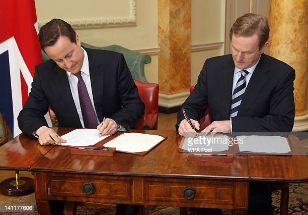 British Prime Minister David Cameron and Taoiseach Enda Kenny sign a 10 year British and Irish Relations Joint Statement at 10 Downing Street on...