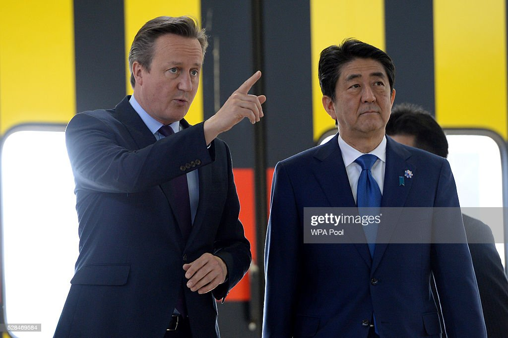 British Prime Minister, <a gi-track='captionPersonalityLinkClicked' href=/galleries/search?phrase=David+Cameron+-+Politician&family=editorial&specificpeople=227076 ng-click='$event.stopPropagation()'>David Cameron</a>, and the Prime Minister of Japan, Shinzo Abe, tour the Hitachi North Pole train maintenance Depot in West London on May 5, 2016 in London, England. Prime Minister Shinzo Abe is on a week-long tour of Europe and Russia ahead of hosting this month's G-7 summit. Prime Minister Abe has warned that Brexit would make the UK 'less attractive' to Japanese investors.