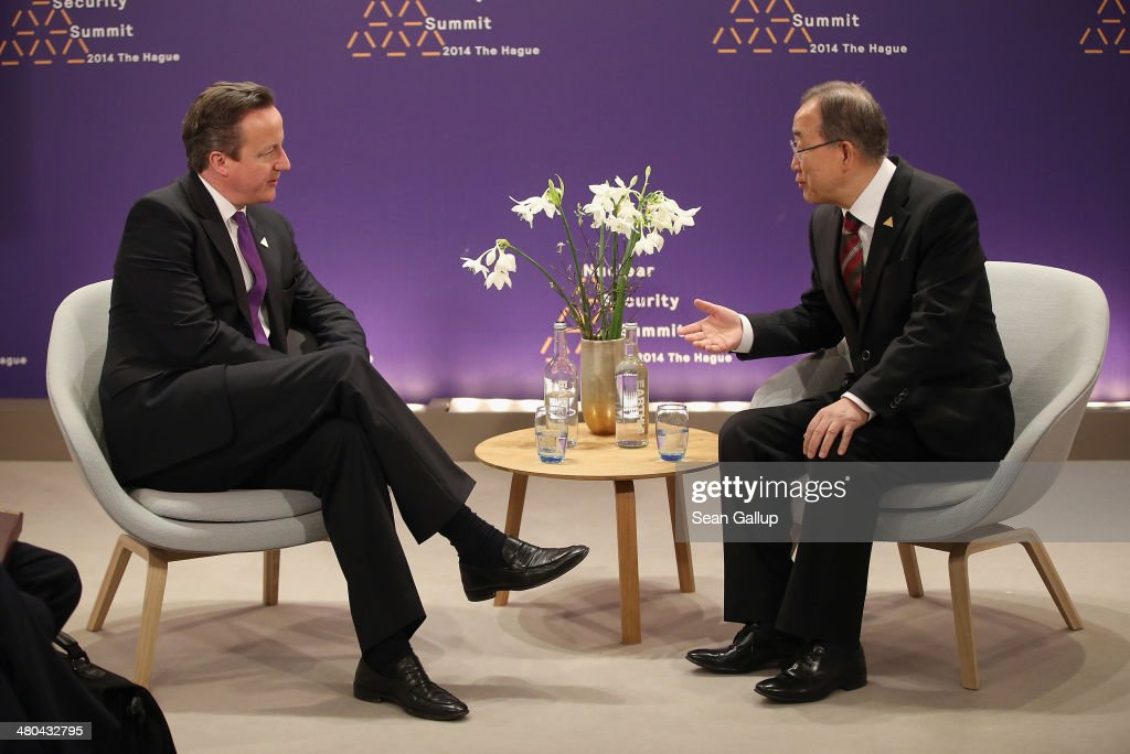 British Prime Minister David Cameron (L) and U.N. Secretary General Ban Ki-moon speak with one another during bilateral talks at the 2014 Nuclear Security Summit on March 25, 2014 in The Hague, Netherlands. Leaders from around the world have come to discuss matters related to international nuclear security, though the summit is overshadowed by recent events in Ukraine.
