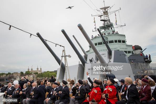 British Prime Minister David Cameron and veterans watch a C75 Dakota flypast along the river Thames from aboard the HMS Belfast during 70th...