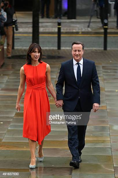 British Prime Minister David Cameron and wife Samantha arrive for the fourth and final day of the Conservative Party Conference at Manchester Central...