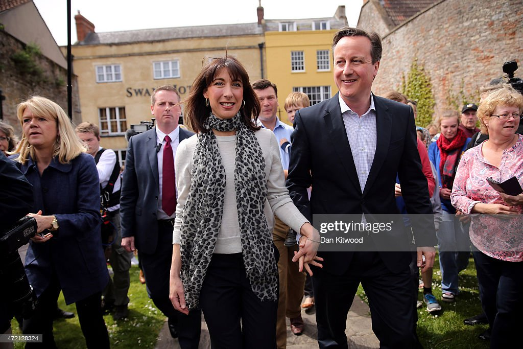 British Prime Minister David Cameron and wife Samantha Cameron speak to members of the public as they walk around the Wells May Day Fate on May 4, 2015 in Bath, United Kingdom. Campaigning is intensifying as the election enters it's last few days before voting begins on May 7, 2015.