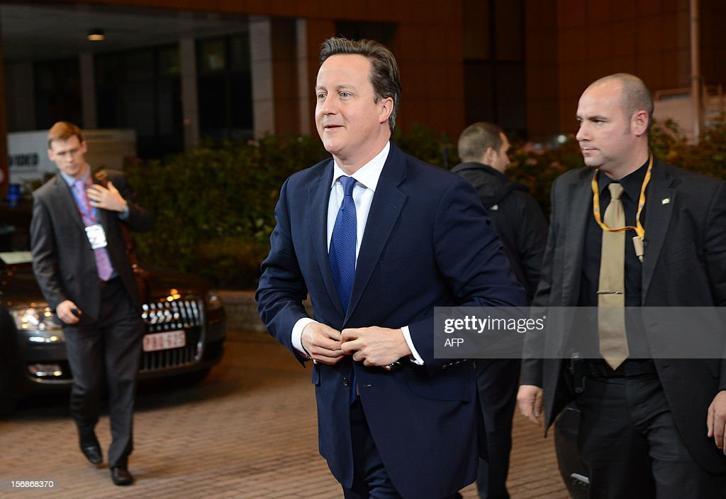 British Prime Minister David Cameron arrives at the EU Headquarters on November 22, 2012 in Brussels, to take part in a two-day European Union leaders summit called to agree a hotly-contested trillion-euro budget through 2020. European Union officials were scrambling to find an all but impossible compromise on the 2014-2020 budget that could successfully move richer nations looking for cutbacks closer to poorer ones who look to Brussels to prop up hard-hit industries and regions.