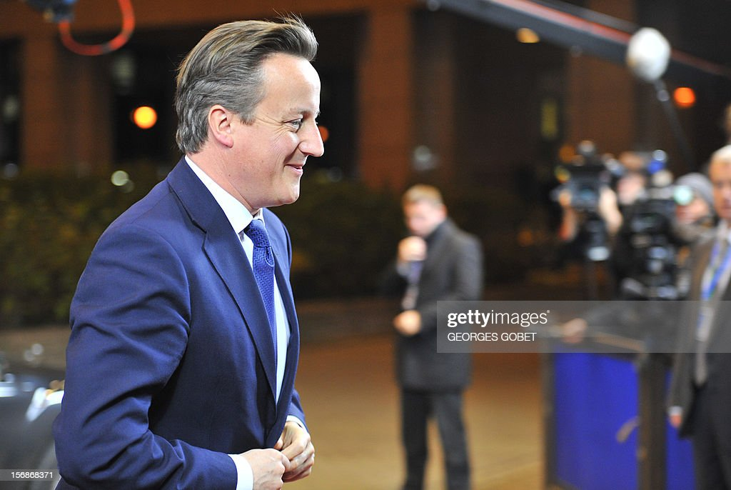 British Prime Minister David Cameron arrives at the EU Headquarters on November 22, 2012 in Brussels, to take part in a two-day European Union leaders summit called to agree a hotly-contested trillion-euro budget through 2020. European Union officials were scrambling to find an all but impossible compromise on the 2014-2020 budget that could successfully move richer nations looking for cutbacks closer to poorer ones who look to Brussels to prop up hard-hit industries and regions. AFP PHOTO / GEORGES GOBET