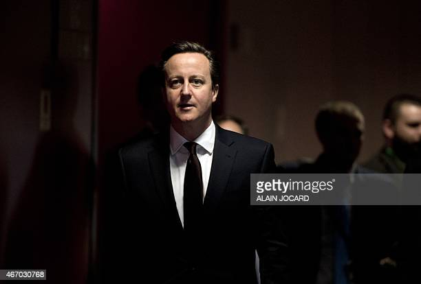 British Prime Minister David Cameron arrives for a press conference on March 20 2015 at the end of a European Union summit at the EU Council building...